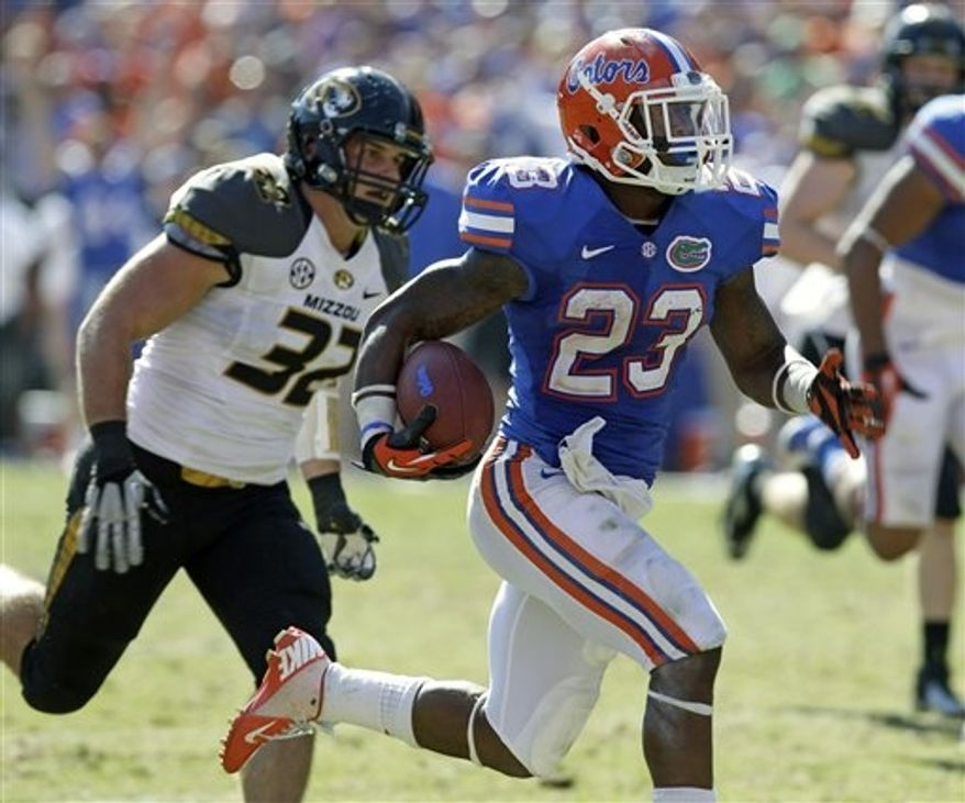 Florida running back Mike Gillislee (23) runs past Missouri linebacker Will Ebner (32) after a pass reception for a 45-yard touchdown during the second half of an NCAA college football game, Saturday, Nov. 3, 2012, in Gainesville, Fla. Florida won the game 14-7. (AP Photo/John Raoux)