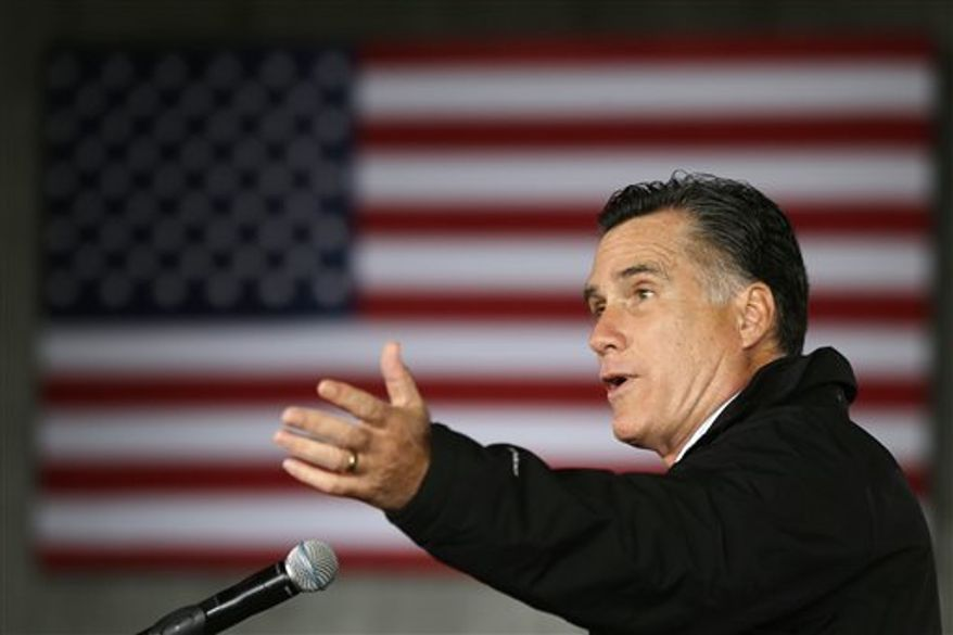 Republican presidential candidate and former Massachusetts Gov. Mitt Romney speaks as he campaigns at Dubuque Regional Airport, in Dubuque, Iowa, Saturday, Nov. 3, 2012. (AP Photo/Charles Dharapak)