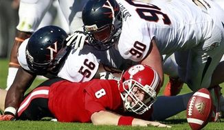 North Carolina State quarterback Mike Glennon (8) fumbles the ball after being sacked by Virginia defensive tackle Chris Brathwaite (56) and defensive end Jake Snyder (90) during the first half of their NCAA college football game, Saturday, Nov. 3, 2012, in Raleigh, N.C. Virginia recovered the ball and went on to win 33-6. (AP Photo/The News & Observer, Ethan Hyman)