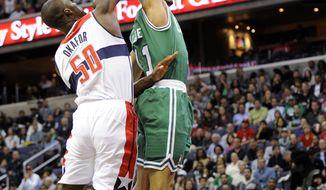 Washington Wizards center Emeka Okafor (50) defends the basket against Boston Celtics guard Courtney Lee (11) during the first half of an NBA basketball game on Saturday, Nov. 3, 2012, in Washington. (AP Photo/Nick Wass)