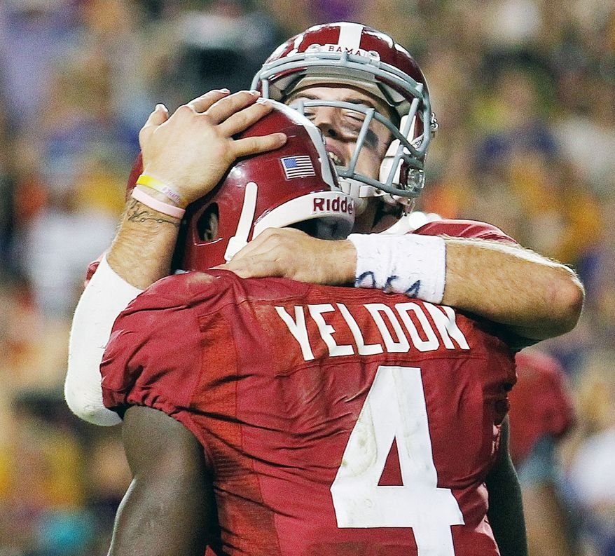 Alabama quarterback AJ McCarron, rear, congratulates running back T.J. Yeldon (4) after the two hooked up for the winning touchdown to defeat LSU 21-17 in an NCAA college football game in Baton Rouge, La., Saturday, Nov. 3, 2012. (AP Photo/Bill Haber)