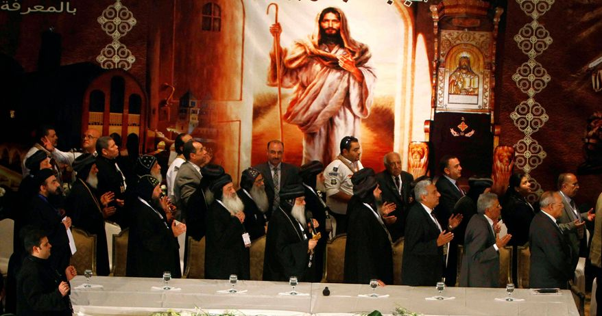 Coptic Bishops pray prior to a press conference held to announce the three finalists for the new Coptic pope in Cairo last week. (Associated Press)