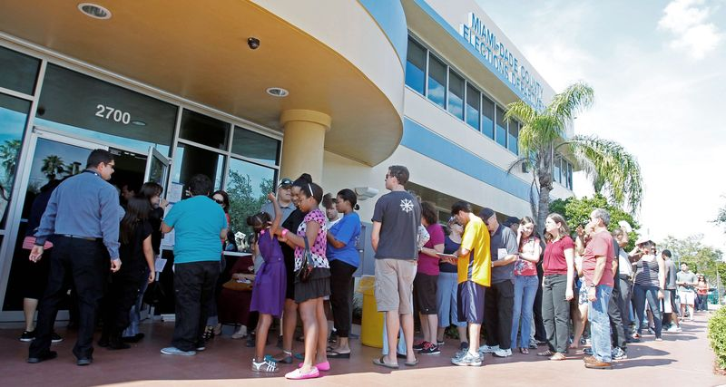 Voters wait to pick up their absentee ballots in Doral, Fla., on Sunday. Christina White, deputy supervisor with Miami-Dade County, said the county decided to accept absentee ballots for four hours on Sunday at its main office. An estimated 25 million voters are expected to vote early this year nationwide, the most in U.S. history. (Associated Press)