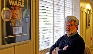 """Producer-director George Lucas, who created the """"Star Wars"""" franchise, poses at Skywalker Ranch in San Rafael, Calif., in 2005. (AP Photo/Eric Risberg)"""