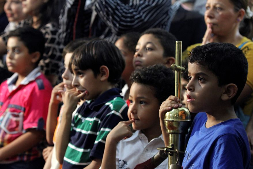 In this Saturday Nov. 3, 2012 photo, young boys wait anxiously to hear which one of them will be selected to chose the new pope in a ceremony where the lucky boy will be blindfolded and pull one of three names from a crystal chalice.  Egypt's ancient Coptic Christian church named a new pope on Sunday, Nov. 4, 2012. (AP Photo/Mohammed Abu Zeid)