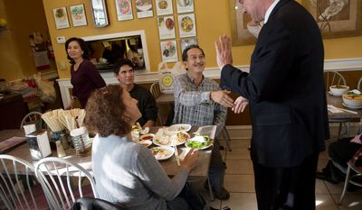 With two days before Election Day, Democratic U.S. Senate candidate and former Virginia Governor Tim Kaine meets with customers at Saigon Restaurant prior to a rally at Eden Center. (Rod Lamkey Jr./The Washington Times)