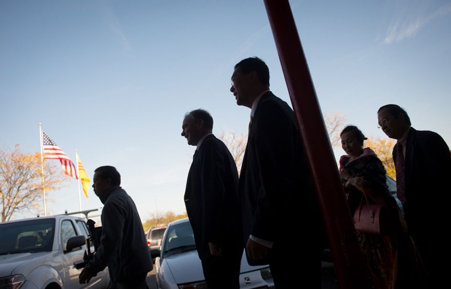 Democratic U.S. Senate candidate and former Virginia Governor Tim Kaine (second from left) arrives to meet customers and business owners at Eden Center in Falls Church, Va., Sunday, Nov. 4, 2012. (Rod Lamkey Jr./The Washington Times)