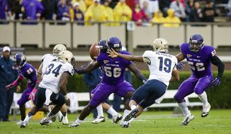 Navy quarterback Keenan Reynolds flips an option pass against East Carolina during an NCAA college football game Saturday, Oct. 27, 2012, in Greenville, N.C. Navy won 56-28. (AP Photo/The Daily Reflector, Rob Taylor)