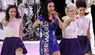 """Pop singer Katy Perry performs before President Obama arrives at a campaign event on Saturday, Nov. 3, 2012, in Milwaukee. """"Forward,"""" Mr. Obama's campaign slogan, is emblazoned on her dress. (AP Photo/Morry Gash)"""