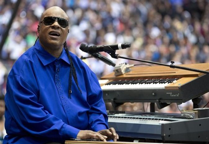 Singer Stevie Wonder performs before President Obama speaks at a campaign event at the Fifth Third Arena on the University of Cincinnati campus, Sunday, Nov. 4, 2012, in Cincinnati. (AP Photo/Carolyn Kaster)