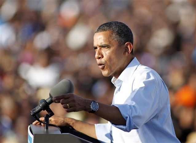 President Obama speaks during a campaign event at McArthur High School in Hollywood, Fla. Sunday, Nov. 4, 2012. (AP Photo/Terry Renna)