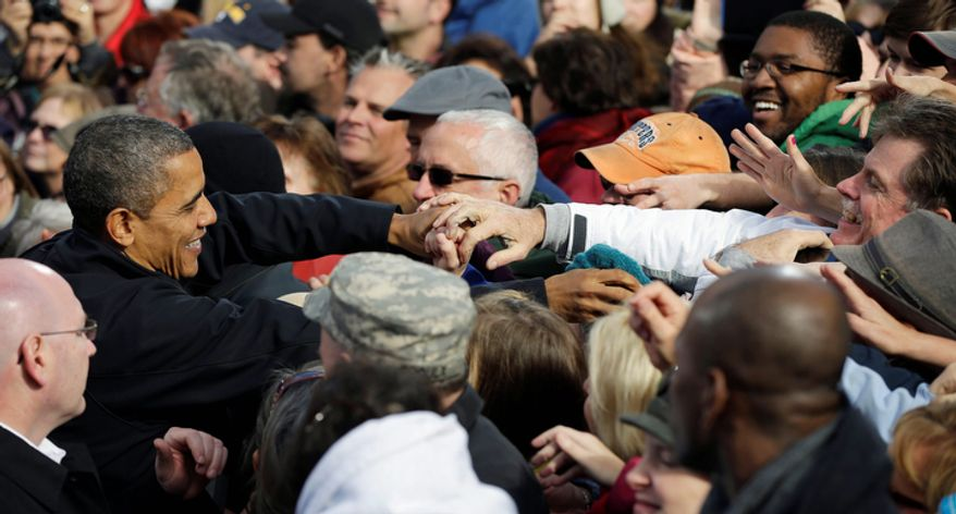 President Barack Obama greets supporters after speaking at a campaign event at Capitol Square, Sunday, Nov. 4, 2012, in Concord, N.H. (AP Photo/Pablo Martinez Monsivais)