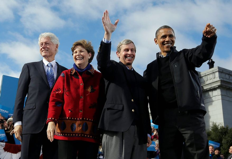 From left to right, former President Bill Clinton, Sen. Jeanne Shaheen, D-N.H., New Hampshire Gov. John Lynch, and President Barack Obama, wave on stage together during a campaign event at Capitol Square, Sunday, Nov. 4, 2012, in Concord, N.H. (AP Photo/Pablo Martinez Monsivais)