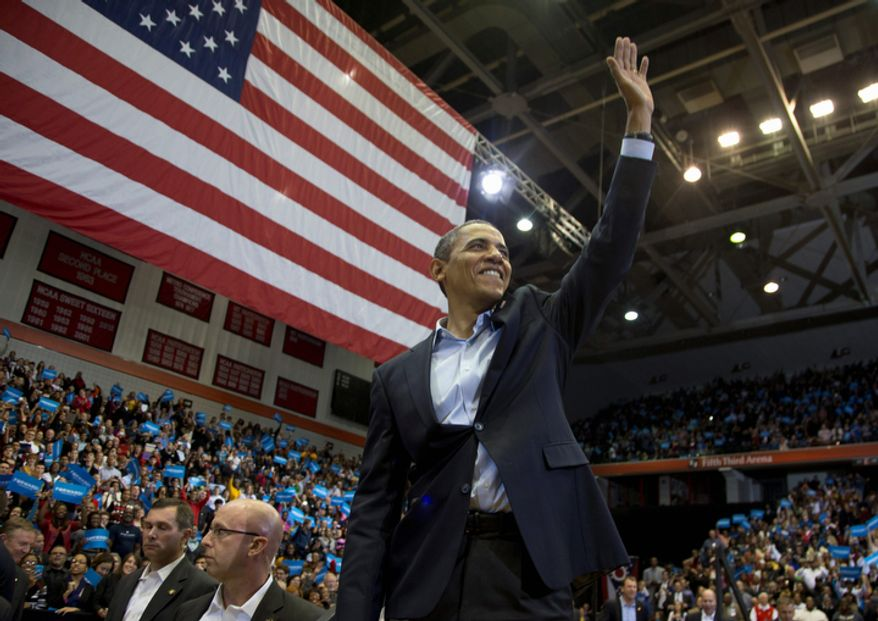 President Barack Obama waves to the crowd as he leaves the stage after speaking at a campaign event at the Fifth Third Arena on the University of Cincinnati campus, Sunday, Nov. 4, 2012, in Cincinnati.  (AP Photo/Carolyn Kaster)