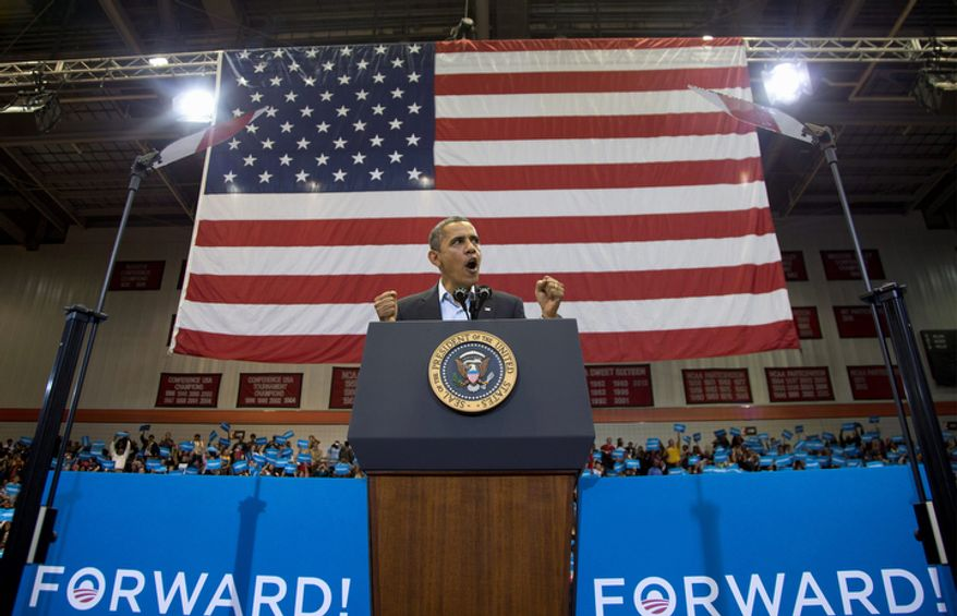 President Barack Obama speaks at a campaign event at the Fifth Third Arena on the University of Cincinnati campus, Sunday, Nov. 4, 2012, in Cincinnati.  (AP Photo/Carolyn Kaster)