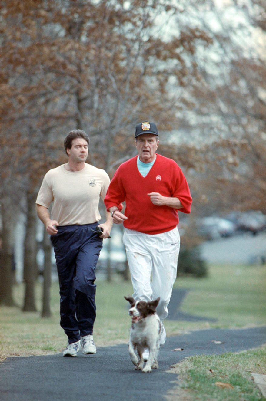 President George H.W. Bush  with his dog Ranger as he starts out jogging on Thursday, Feb. 15, 1991 afternoon in Washington when the temperatures reached the mid-fifties.  (AP Photo/Dennis Cook)