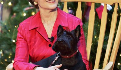 First lady Laura Bush, holds her pet dog Barney during a visit to the Children's National Medical Center, Wednesday, Dec. 15, 2004, in Washington. (AP Photo/Manuel Balce Ceneta)