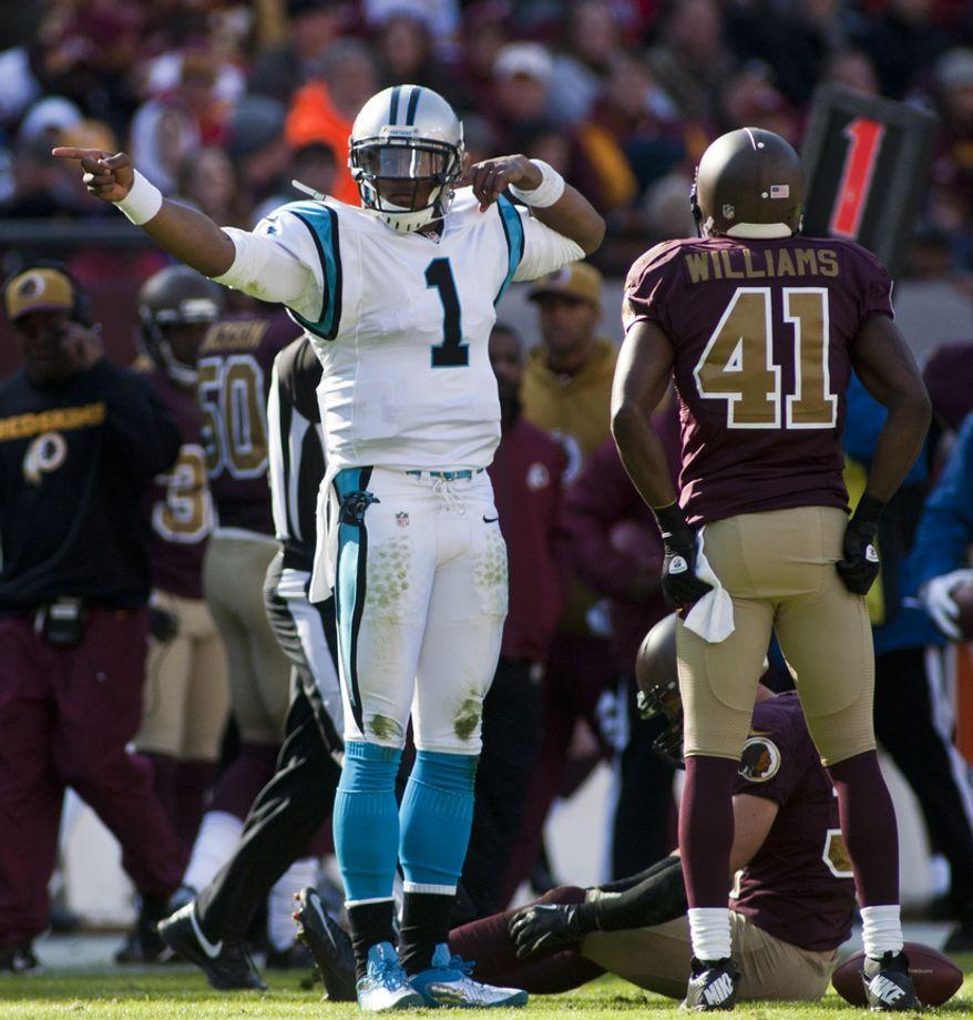 Carolina Panthers quarterback Cam Newton (1) celebrates a first down in the first quarter against the Washington Redskins, Landover, Md., Sunday, November 4, 2012.  (Craig Bisacre/The Washington Times)