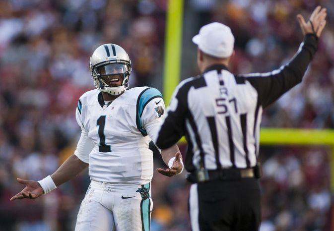 Carolina Panthers quarterback Cam Newton (1) argues a delay of game call in the fourth quarter against the Washington Redskins, Landover, Md., Sunday, November 4, 2012.  (Craig Bisacre/The Washington Times)