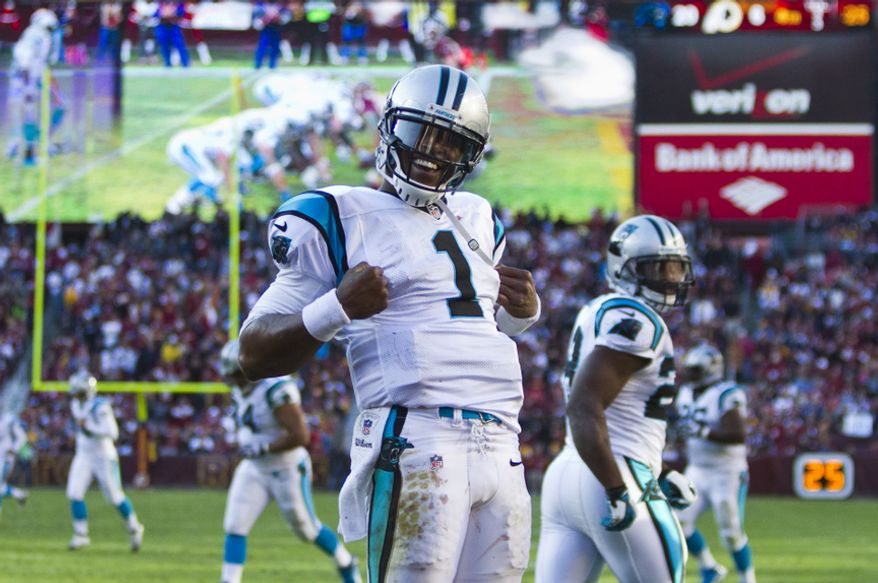 Carolina Panthers quarterback Cam Newton (1) celebrates after scoring a 1 yard touchdown run in the fourth quarter against the Washington Redskins, Landover, Md., Sunday, November 4, 2012.  (Craig Bisacre/The Washington Times)