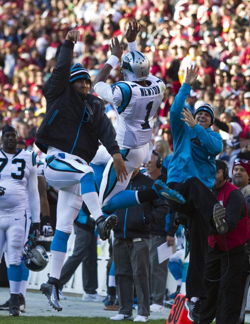 Carolina Panthers quarterback Cam Newton (1) celebrates after scoring a 1 yard touchdown run in the fourth quarter against the Washington Redskins, Landover, Md., Sunday, November 4, 2012.  (Craig Bisacre/The Washington Times)