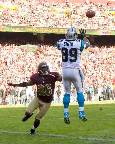 Carolina Panthers wide receiver Steve Smith (89) scores on a 19 yard passing play over Washington Redskins cornerback Josh Wilson (26) to put the Carolina Panthers up 14-3 against the Washington Redskins in the second quarter at FedEx Field, Landover, Md., Sunday, November 4, 2012. (Andrew Harnik/The Washington Times)
