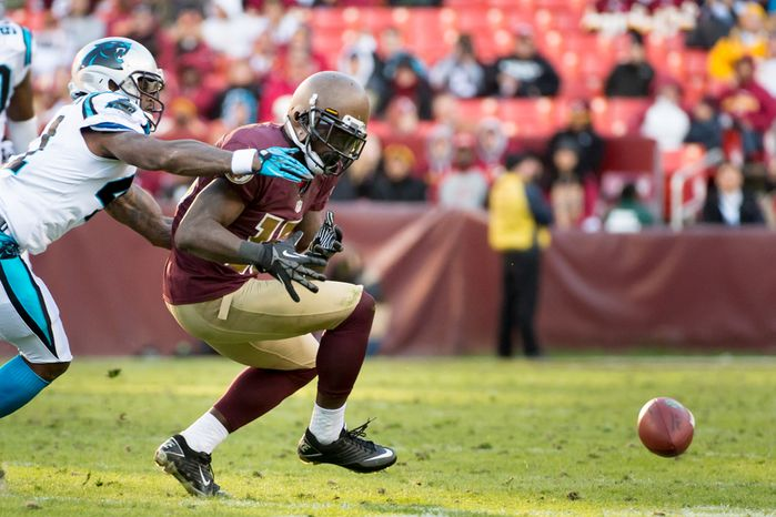 Washington Redskins wide receiver Josh Morgan (15) drops a pass in the fourth quarter as the Washington Redskins take on the Carolina Panthers at FedEx Field, Landover, Md., Sunday, November 4, 2012. (Andrew Harnik/The Washington Times)