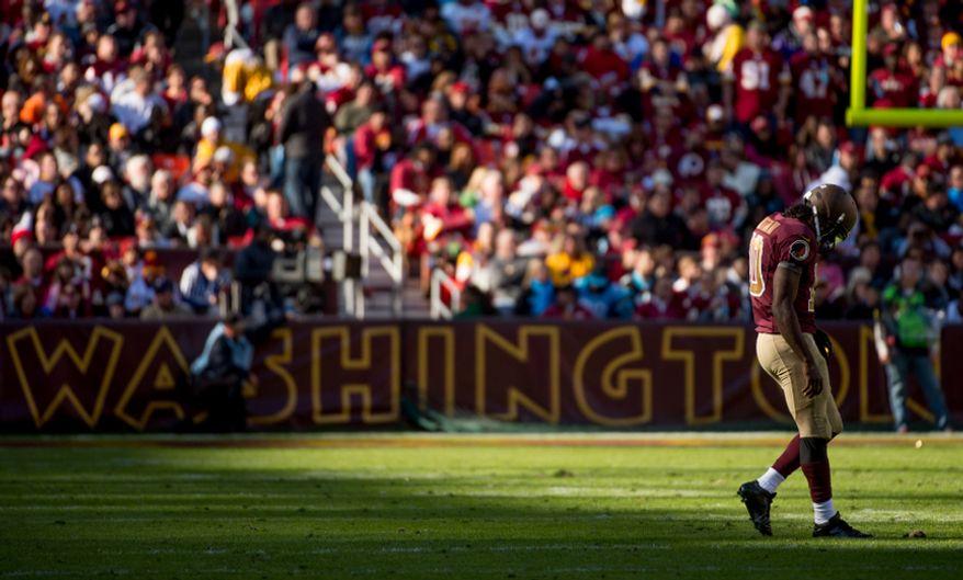 Washington Redskins quarterback Robert Griffin III (10) takes the field as the Washington Redskins take on the Carolina Panthers at FedEx Field, Landover, Md., Sunday, November 4, 2012. (Andrew Harnik/The Washington Times)