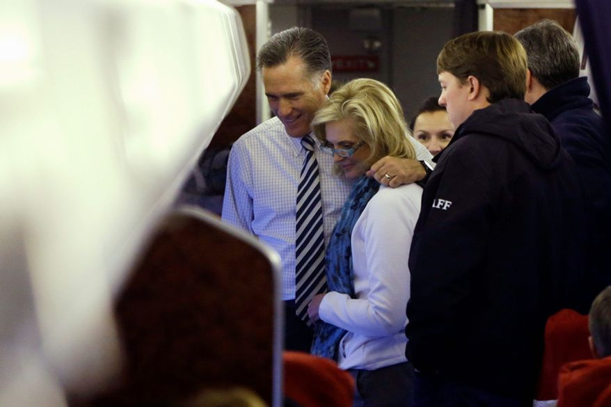 Republican presidential candidate and former Massachusetts Gov. Mitt Romney stands with Ann Romney on their plane after they campaigned at the International Exposition Center in Cleveland, Sunday, Nov. 4, 2012. (AP Photo/Charles Dharapak)