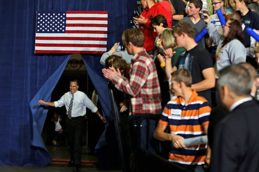 Republican presidential candidate and former Massachusetts Gov. Mitt Romney emerges from backstage to campaign at Iowa Events Center, in Des Moines, Iowa, Sunday, Nov. 4, 2012. (AP Photo/Charles Dharapak)