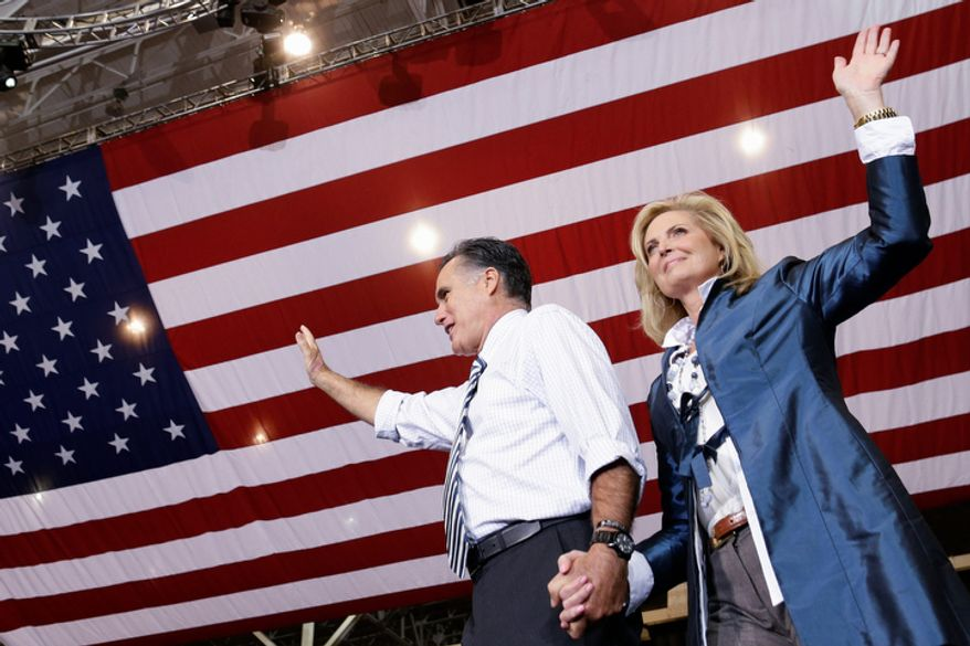 Republican presidential candidate and former Massachusetts Gov. Mitt Romney holds his wife Ann's hand as they arrive to campaign at the International Exposition Center in Cleveland, Sunday, Nov. 4, 2012. (AP Photo/Charles Dharapak)