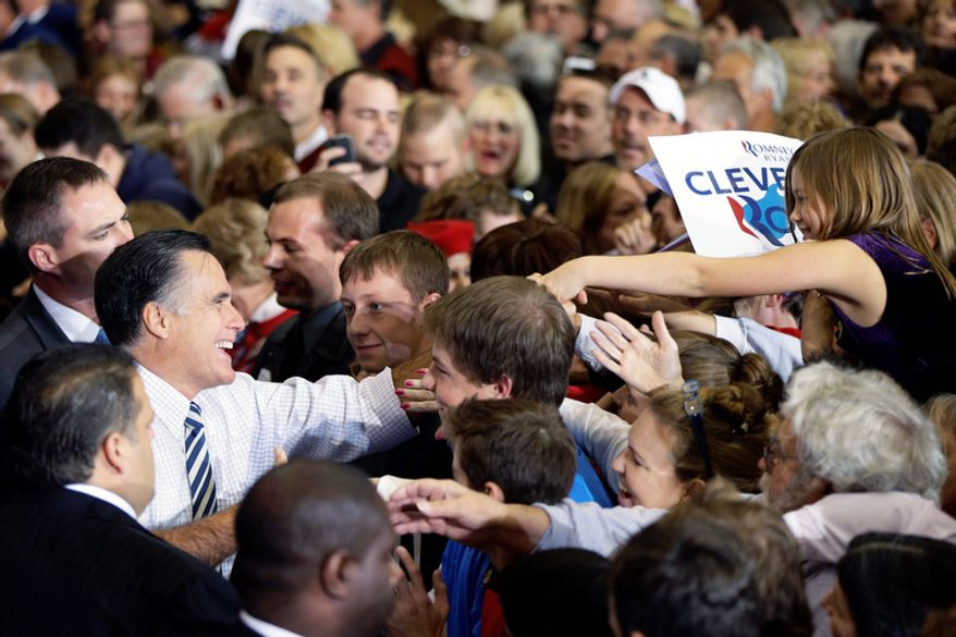 Republican presidential candidate and former Massachusetts Gov. Mitt Romney greets supporters as he campaigns at the International Exposition Center in Cleveland, Sunday, Nov. 4, 2012. (AP Photo/Charles Dharapak)