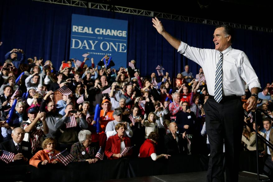 Republican presidential candidate and former Massachusetts Gov. Mitt Romney walks out on stage as he campaigns at Iowa Events Center, in Des Moines, Iowa, Sunday, Nov. 4, 2012. (AP Photo/Charles Dharapak)