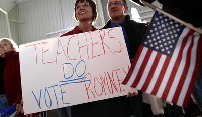 Tom and Regina Theisen of Loudonville, Ohio, take part in a campaign event for Republican vice presidential candidate, Rep. Paul Ryan, R-Wis., Sunday, Nov. 4, 2012, in Mansfield, Ohio. (AP Photo/Mary Altaffer)