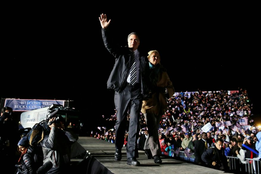 Republican presidential candidate and former Massachusetts Gov. Mitt Romney and his wife Ann Romney take the stage at a Pennsylvania campaign rally at Shady Brook Farm, in Morrisville, Pa., Sunday, Nov. 4, 2012. (AP Photo/Charles Dharapak)