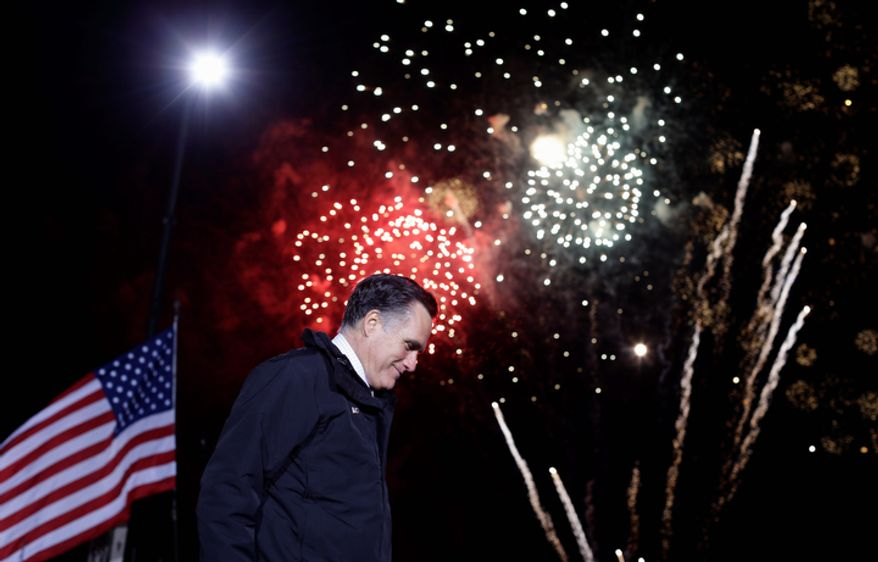 Republican presidential candidate and former Massachusetts Gov. Mitt Romney leaves the stage as fireworks explode behind him at a Pennsylvania campaign rally at Shady Brook Farm, in Morrisville, Pa., Sunday, Nov. 4, 2012. (AP Photo/Charles Dharapak)
