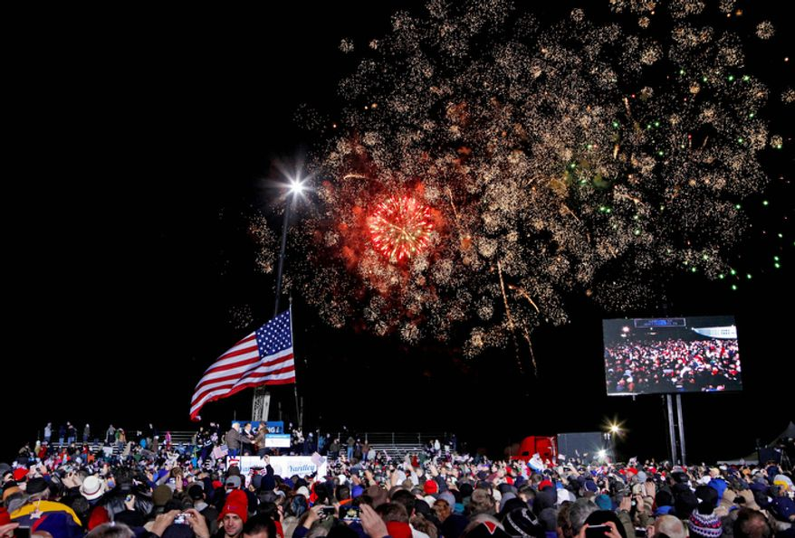 Fireworks go off as Republican presidential candidate, former Massachusetts Gov. Mitt Romney finishes his speech on stage at a campaign event at Shady Brook Farm, Sunday, Nov. 4, 2012, in Morrisville, Pa. (AP Photo/David Goldman)