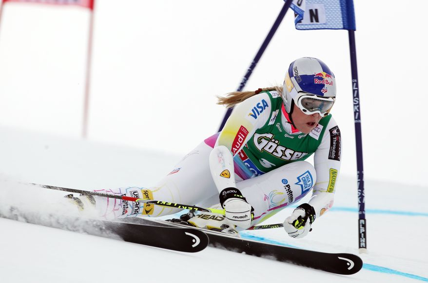 ** FILE ** In this Saturday, Oct. 27, 2012, file photo, Lindsey Vonn, of the U.S., clears a gate during the first run of an alpine ski, women's World Cup giant slalom, in Soelden, Austria. Vonn's request to compete in a men's World Cup downhill race has been rejected by the International Ski Federation. (AP Photo/Alessandro Trovati, File)