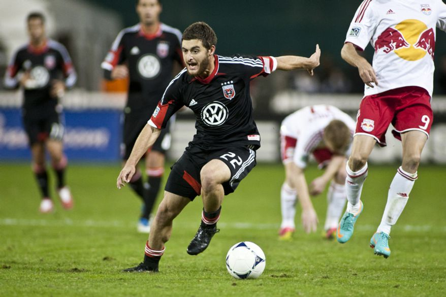 D.C. United defender Chris Korb (22) dodges defenders during the first half against the New York Red Bulls in the Eastern Conference semifinals playoff match at RFK Stadium, Washington, D.C.,  Saturday, Nov. 3, 2012. (Craig Bisacre/The Washington Times)