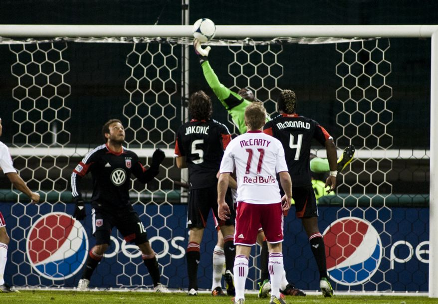 D.C. United goalkeeper Bill Hamid (28) knocks the ball into his own goal during the second half of the Eastern Conference semifinals playoff match at RFK Stadium, Washington, D.C.,  Saturday, Nov. 3, 2012. (Craig Bisacre/The Washington Times)