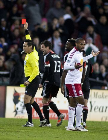 The referee gives Andy Najar a red card for his second yellow in the second half against the New York Red Bulls in the Eastern Conference semifinals playoff match at RFK Stadium, Washington, D.C.,  Saturday, Nov. 3, 2012. (Craig Bisacre/The Washington Times)