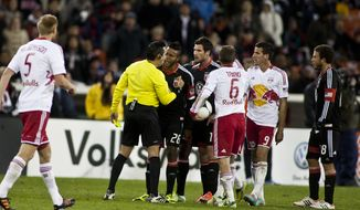 ** FILE ** D.C. United midfielder Andy Najar (14) receives his second yellow card equaling a red card in the second half against the New York Red Bulls in the Eastern Conference semifinals playoff match at RFK Stadium, Washington, D.C., Saturday, Nov. 3, 2012. (Craig Bisacre/The Washington Times)