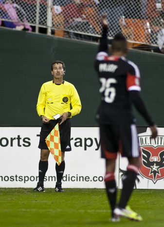 D.C. United forward Lionard Pajoy (26) argues with the sideline ref during the second half against the New York Red Bulls in the Eastern Conference semifinals playoff match at RFK Stadium, Washington, D.C.,  Saturday, Nov. 3, 2012. (Craig Bisacre/The Washington Times)