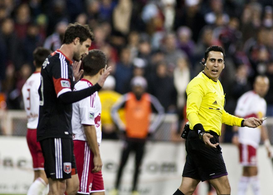 D.C. United midfielder-forward Chris Pontius argues the call on midfielder Andy Najar (14) who received his second yellow card equalling a red card in the second half against the New York Red Bulls in the Eastern Conference semifinals playoff match at RFK Stadium, Washington, D.C.,  Saturday, Nov. 3, 2012. (Craig Bisacre/The Washington Times)