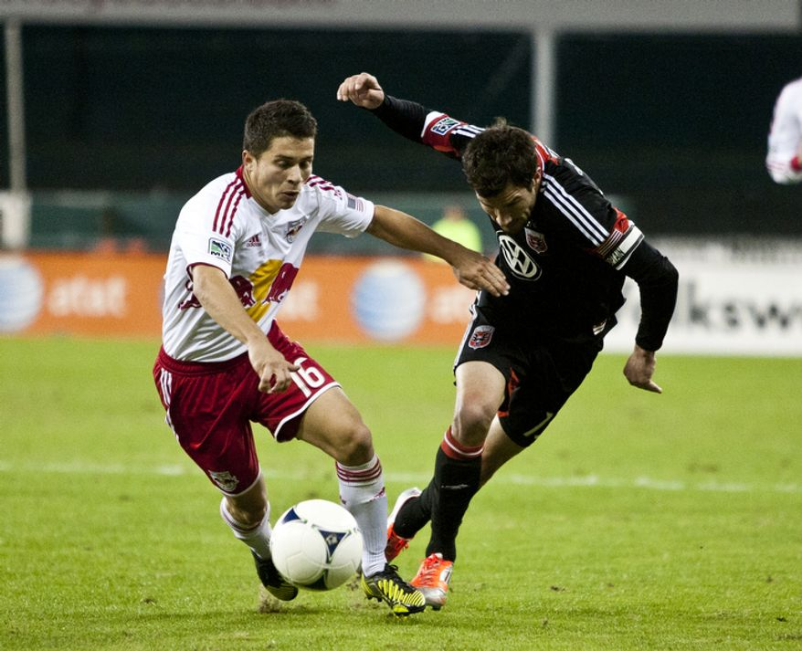 D.C. United midfielder Chris Pontius (13) battles for possession against New York Red Bulls defender Connor Lade (16) during the second half in the Eastern Conference semifinals playoff match at RFK Stadium, Washington, D.C.,  Saturday, Nov. 3, 2012. (Craig Bisacre/The Washington Times)