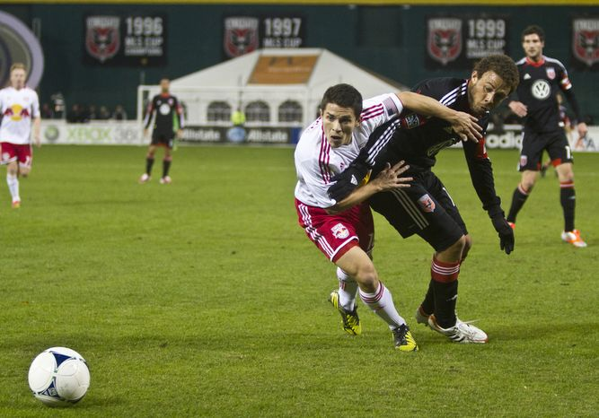 D.C. United midfielder Nick DeLeon (18) fights for possession against New York Red Bulls defender Connor Lade (16) during the first half of the Eastern Conference semifinals playoff match at RFK Stadium, Washington, D.C.,  Saturday, Nov. 3, 2012. (Craig Bisacre/The Washington Times)
