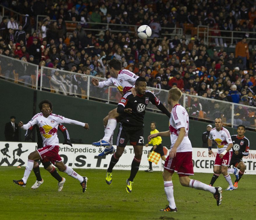 D.C. United forward Lionard Pajoy (26) fights for possession against New York Red Bulls defender Heath Pearce (3) during the second half in the Eastern Conference semifinals playoff match at RFK Stadium, Washington, D.C.,  Saturday, Nov. 3, 2012. (Craig Bisacre/The Washington Times)