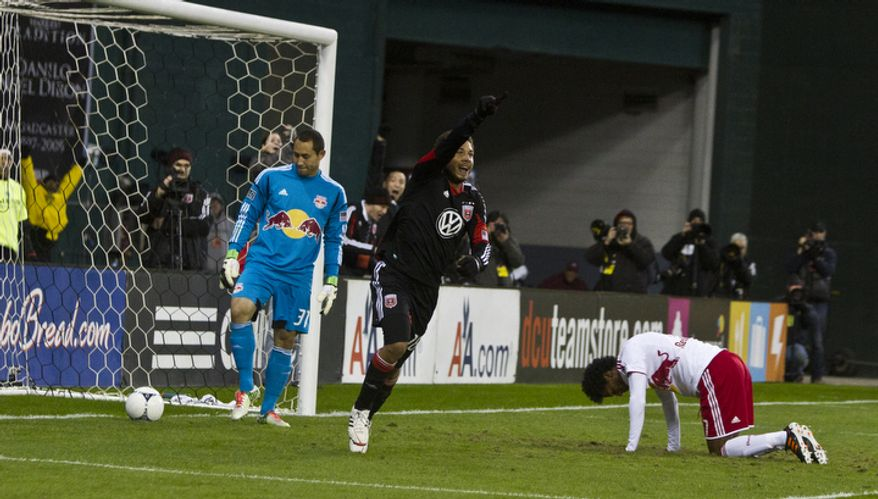 D.C. United midfielder Nick DeLeon (18) celebrates after New York Red Bulls defender Roy Miller (7) scores an own goal during the second half of the Eastern Conference semifinals playoff match at RFK Stadium, Washington, D.C.,  Saturday, Nov. 3, 2012. (Craig Bisacre/The Washington Times)