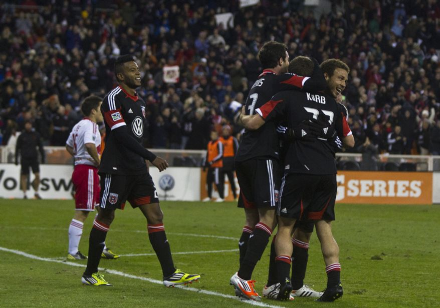 D.C. United celebrates after New York Red Bulls defender Roy Miller (7) scores an own goal during the second half of the Eastern Conference semifinals playoff match at RFK Stadium, Washington, D.C.,  Saturday, Nov. 3, 2012. (Craig Bisacre/The Washington Times)