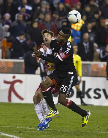 D.C. United forward Lionard Pajoy (26) collides with New York Red Bulls defender Heath Pearce (3) during the second half of the Eastern Conference semifinals playoff match at RFK Stadium, Washington, D.C.,  Saturday, Nov. 3, 2012. (Craig Bisacre/The Washington Times)